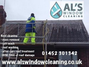 soft wash roof cleaning Gloucester on a scaffold tower